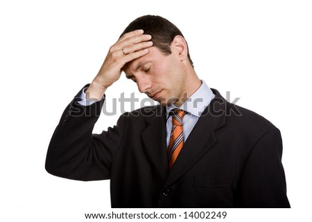 Businessman in a suit gestures with a headache