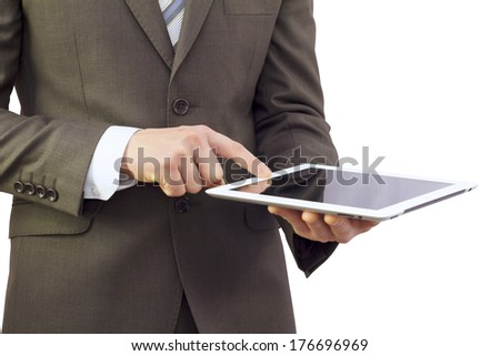 Businessman in a suit holding a tablet computer and finger presses the button