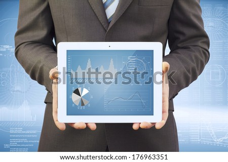 Businessman in a suit holding a tablet computer. The screen tablet - graphics