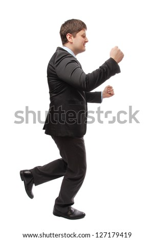 Businessman in a suit running a business meeting - stock photo