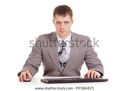 businessman in a suit sitting at a laptop on a white background