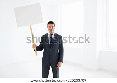 Businessman in a suit with a message - stock photo