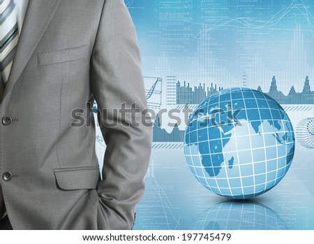 Businessman in a suit with background of Earth and graphics. Business concept - stock photo