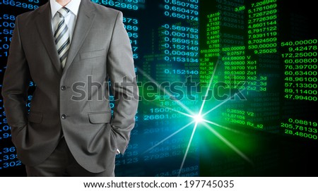 Businessman in a suit with background of green and blue glowing figures
