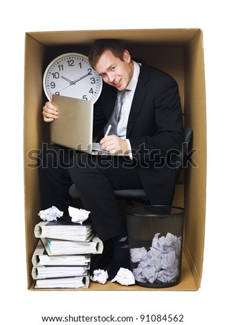 Businessman in a very tight office isolated on white background - stock photo