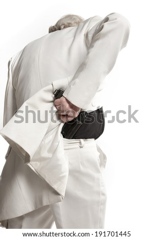 businessman in a white suit holding a gun - stock photo