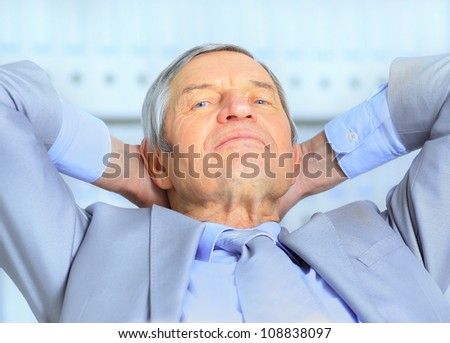 Businessman in age, resting for a break. Isolated on a white background.