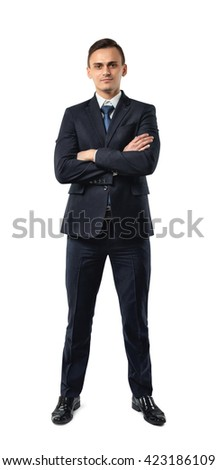 Businessman in an elegant  black suit stands with folded arms isolated on a white background. Cutout portrait. Business staff. Office clothes. Dress code. Presentable appearance. Successful lifestyle - stock photo