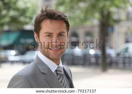 Businessman in an elegant city - stock photo