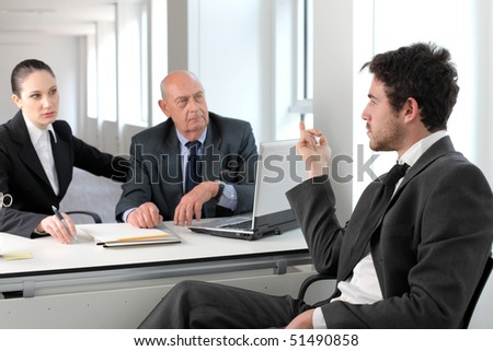 Businessman in an interview with two business people - stock photo