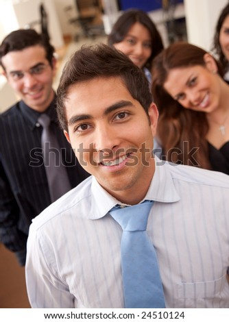 Businessman in an office with his team