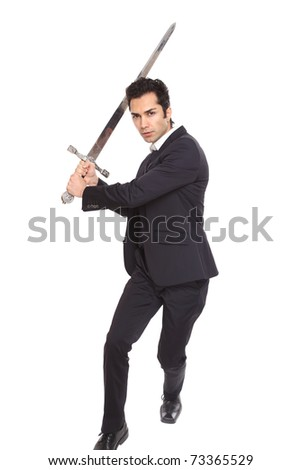 Businessman in attacking posing with a sword - stock photo