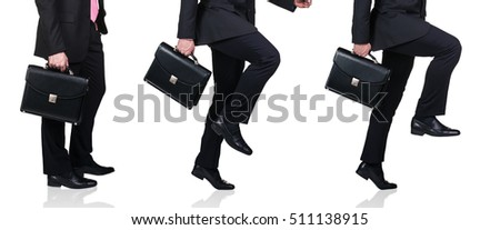 Businessman in black shoes and briefcase walking for next achievement. Isolated on white
