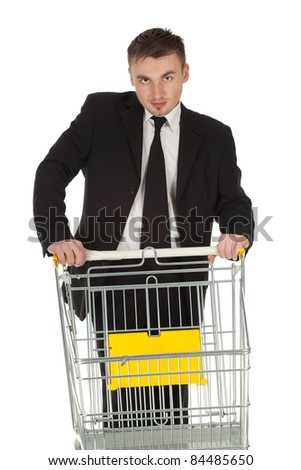 businessman in black suit and shopping cart - stock photo