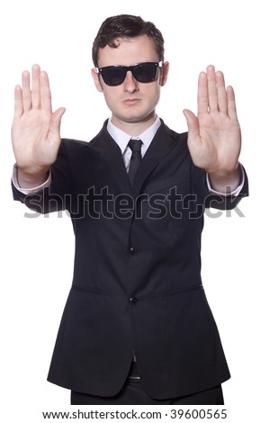 businessman in black suit and sunglasses showing stop, Isolated on white background - stock photo