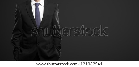 businessman in black suit on a black background