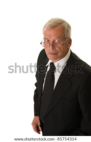 Businessman in black suit over a white background - stock photo
