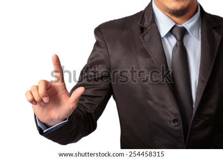 Businessman in black suit pointing on imagination screen - stock photo