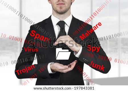 businessman in black suit protecting folder with hands from internet attack malware - stock photo