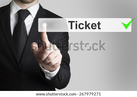 businessman in black suit pushing button ticket - stock photo