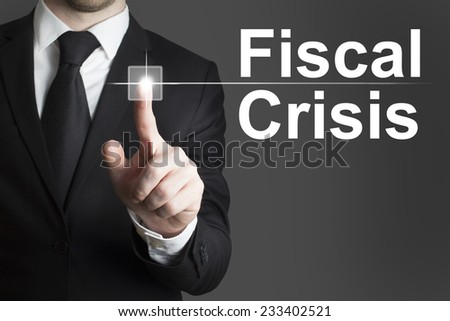 businessman in black suit pushing flat button fiscal crisis - stock photo