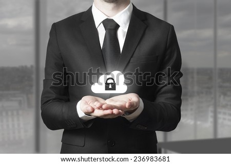 businessman in black suit serving gesture cloud security - stock photo