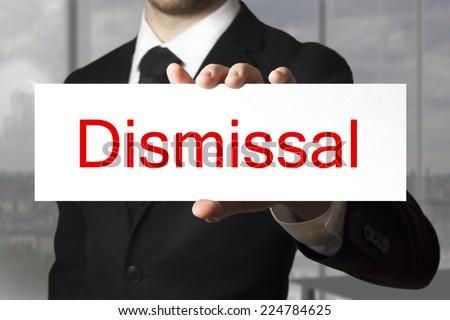 businessman in black suit showing sign dismissal - stock photo