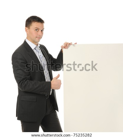 Businessman in black suit with large blank. Isolated on white background - stock photo