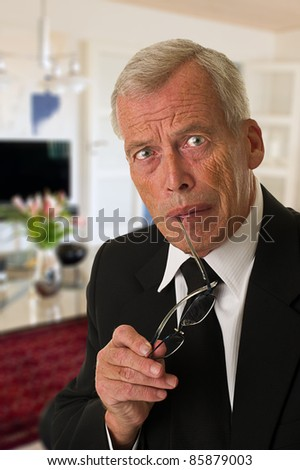 Businessman in black suit wondering - stock photo