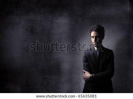 businessman in black with black background - stock photo