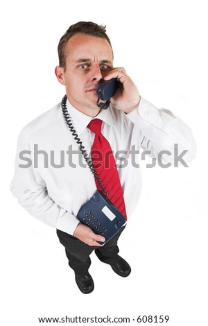 Businessman in blacktrousers, pants, white shirt and red tie.Talking on the phone, looking up. - stock photo