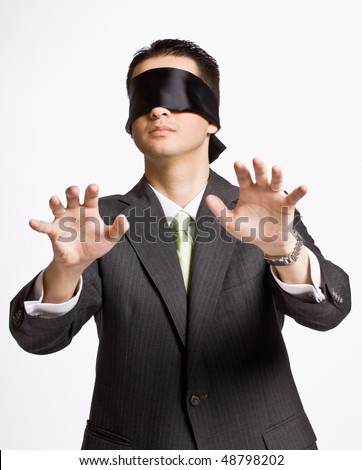 Businessman in blindfold - stock photo