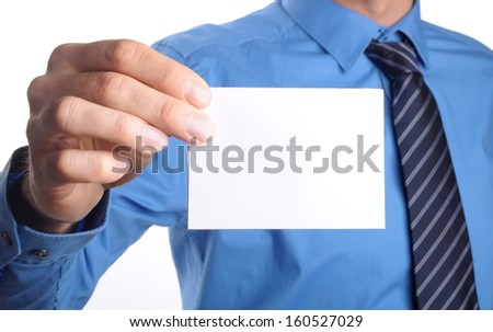 businessman in blue shirt and tie shows someone his business card with copy space - stock photo