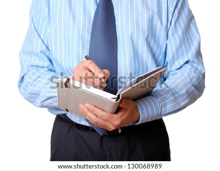 Businessman in blue shirt with notebook and pen writing isolated