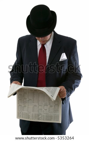 Businessman in bowler hat reading the stocks and share prices in a newspaper. - stock photo