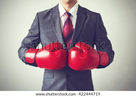 Businessman in boxing gloves isolated on white background - stock photo