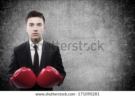 businessman in boxing gloves on background - stock photo