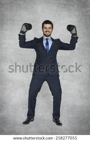 Businessman in boxing gloves raised his hands , victory - stock photo