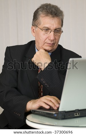 Businessman in business attire with laptop