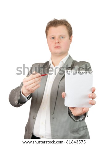 Businessman  in business outfit pointing at blank notebook, over white background