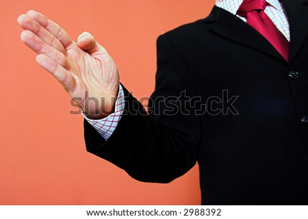 Businessman in business suit offering a hand