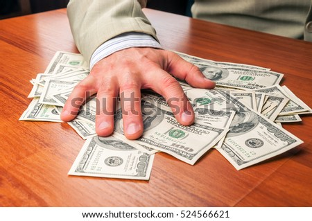 businessman in business suit takes dollars