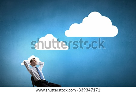 Businessman in chair and blank thought cloud above his head - stock photo