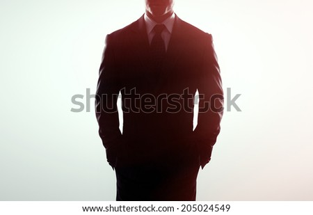 businessman in coat on a white background - stock photo