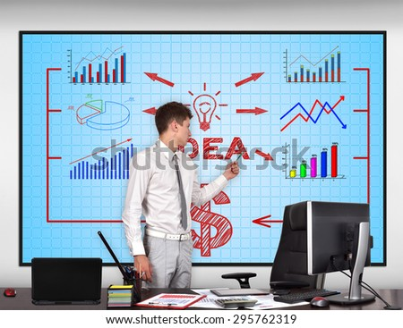 businessman in conference room pointing to idea scheme  on screen - stock photo