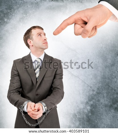 Businessman in cuffs with chain - stock photo