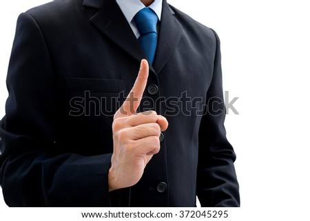 Businessman in dark gray suit raising his fist of success and victory