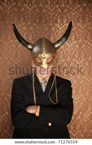 Businessman in dark suit and viking helmet