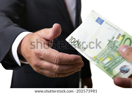 Businessman in dark suit receives a bill