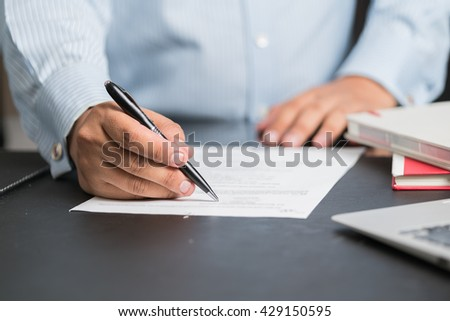 Businessman in elegant suits working with documents sign up contract
